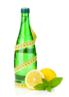 Water bottle, measuring tape, lemon and mint